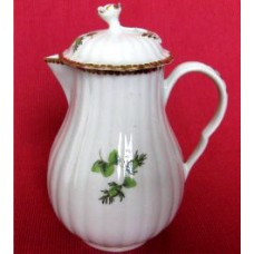 Worcester Pear Shaped Milk Jug and Cover, moulded fluted body, shallow domed cover with flower finial. Decorated in green monochrome with flowers and fruit, c1775