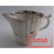 "SOLD Caughley Milk Jug with Tapering Cylindrical Fluted Body, decorated with ""Dresden Sprigs and Festoon Border"", c1790 SOLD"