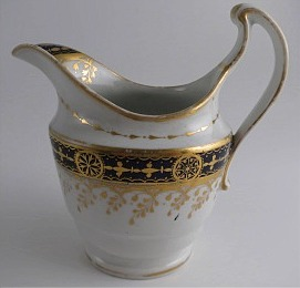 Chamberlain Worcester Oval Shaped Milk Jug, Underglaze Blue and Gilt 'Blue Border with Gold Ovals and Gilded Dropping Foliage' Decoration, Pattern Number 61, c1800-1805