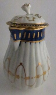 Worcester Pear Shaped Milk Jug and Cover, moulded fluted body, shallow domed cover with flower finial. Decorated in underglaze cobalt blue and rich gilding, c1775