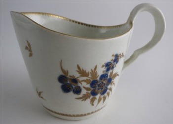 Worcester Milk Jug, Decorated in Underglaze Blue with Formal Flowers, Honey Gold Leaves and Stems, Gold Dentil Rim and Base, c1785