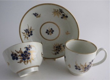Worcester Trio, Decorated in Underglaze Blue with Formal Flowers, Honey Gold Leaves and Stems, Gold Dentil Rim and Base, c1785